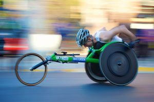 Wheelchair athlete in a race at high speed