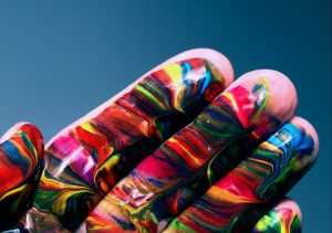 A hand painted cheerfully in multicolored swirls